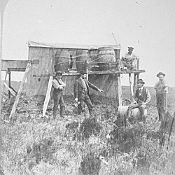 Members of the U.S. transit-of-Venus expedition at the site of Kerguelen Island putting up the water casks at the photography building