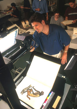 A technician digitizes a rare book in the Libraries' Imaging Center